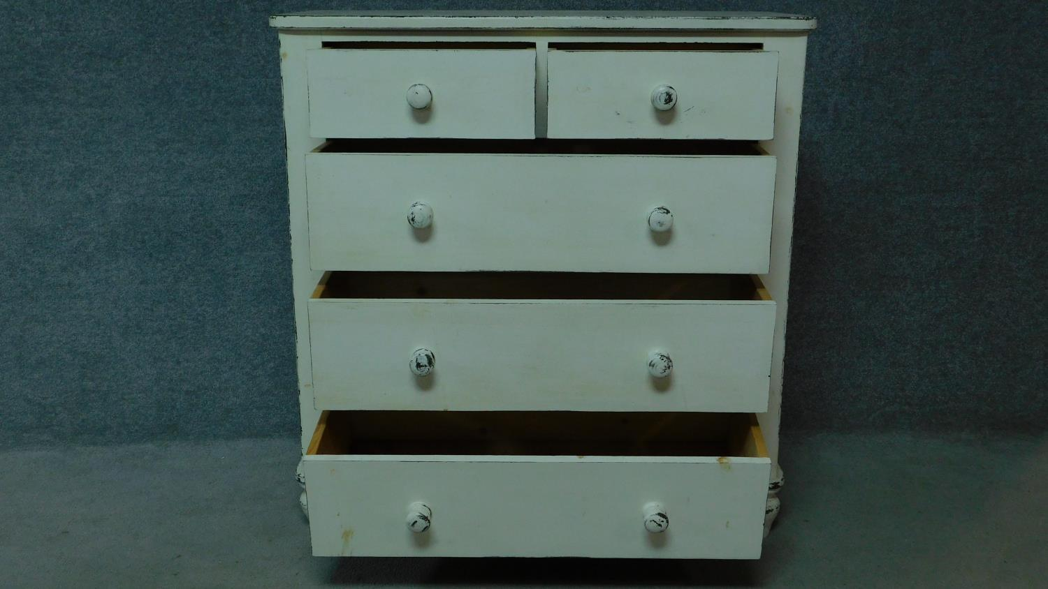 A 19th century distressed painted white chest of two short over three long drawers. H.104 W.100 D. - Image 2 of 5