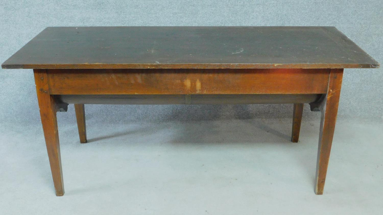 An antique oak dining table with planked lift up top and dough bin fitted to underside. H.74 W.171