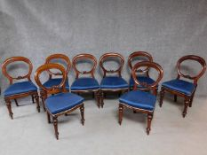 A set of eight Victorian mahogany balloon back dining chairs on turned tapering supports. H.91cm