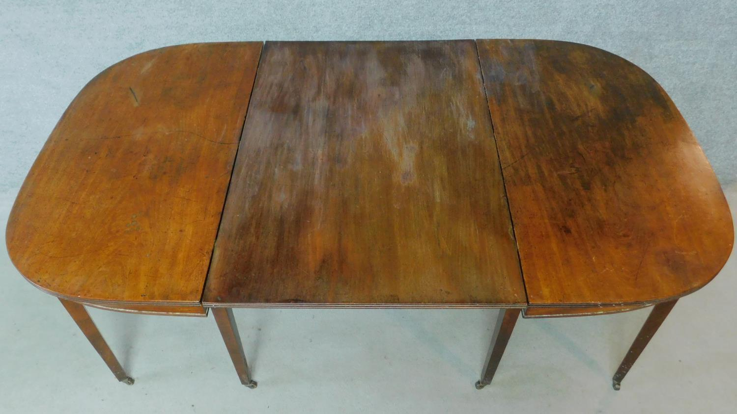 A Georgian mahogany D-end extending dining table on square tapering supports. H.76 L.181 W.55cm ( - Image 6 of 6