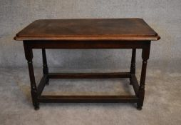 An antique oak hall or centre table on turned stretchered supports. H.76 x 112 x 63cm