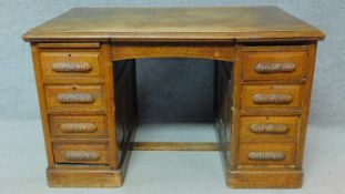 A 19th Century oak desk with eight short drawers on plinth base. H.77 W.126 D.81cm