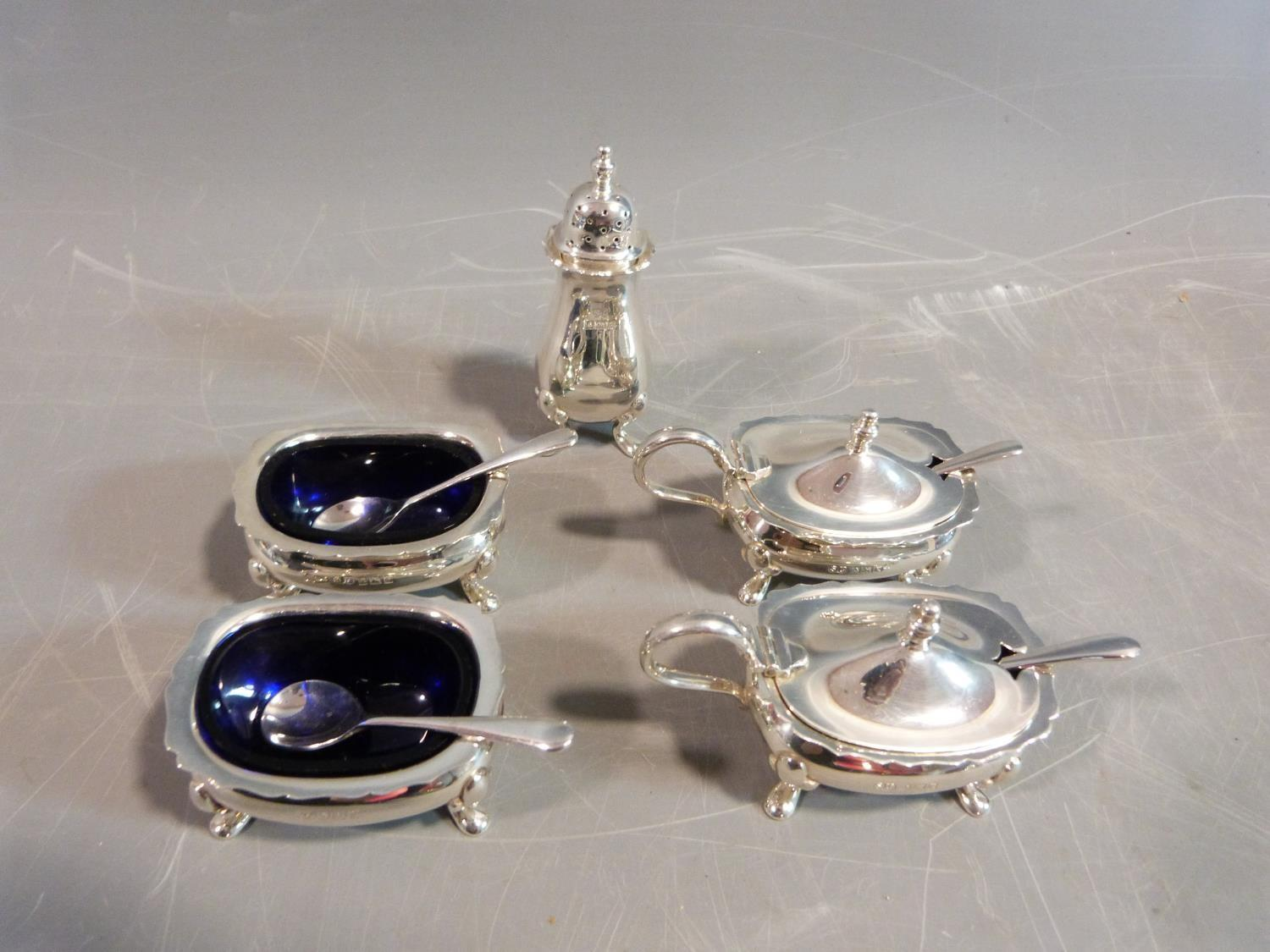 Silver cruets and salts and a pepper shaker. Hallmarked: SLd for William Suckling Ltd,1955,