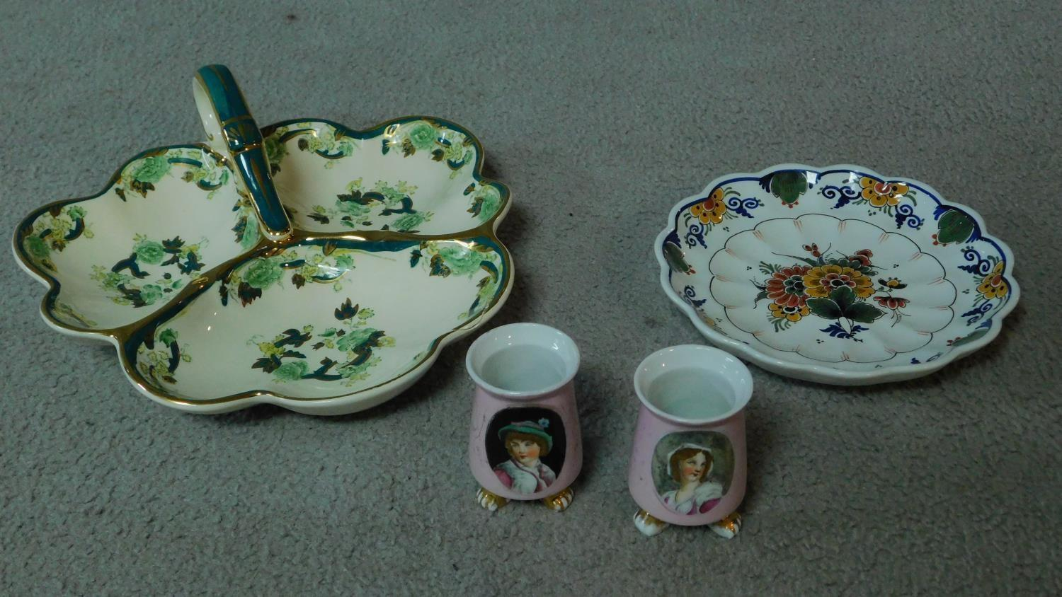 A collection of ceramics. Including a pair of pink transferware salts with a portrait of a man and a