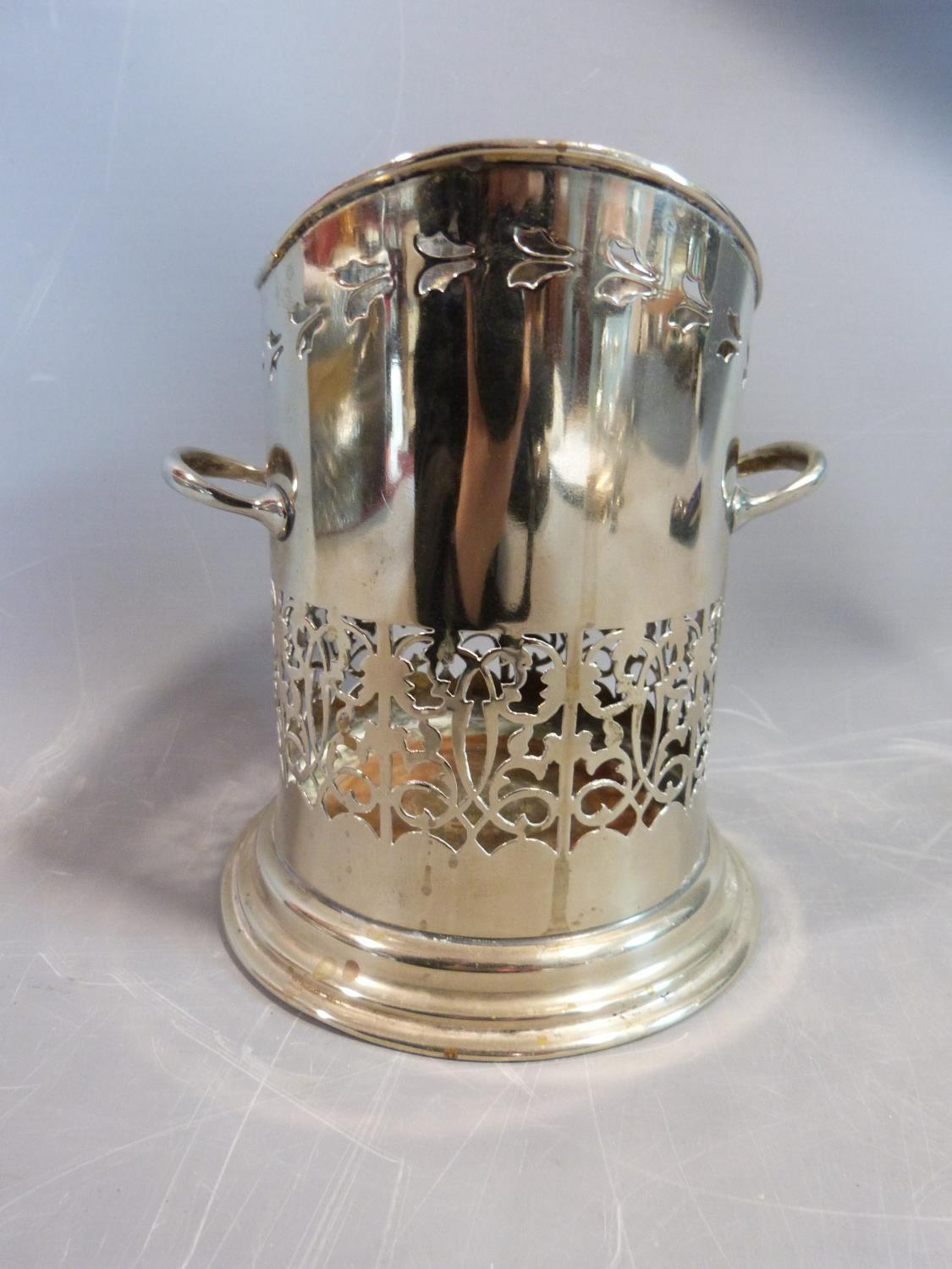 A collection of silver plate items. Including an antique razor ,a pierced two handled wine bottle - Image 6 of 8