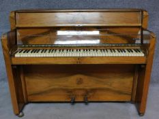 An Art Deco figured walnut upright piano, by Nathaniel Berry & Sons. H.106 W.133 D.48cm