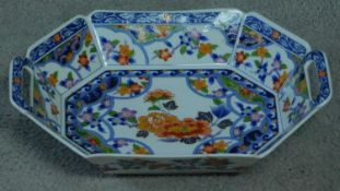 A transfer design oriental handled serving dish. Printed artists seal to base. Decorated with floral