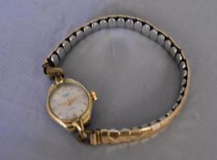 A vintage ladies gold plated hand wound Medana watch. White enamel dial with gold plated markers, on