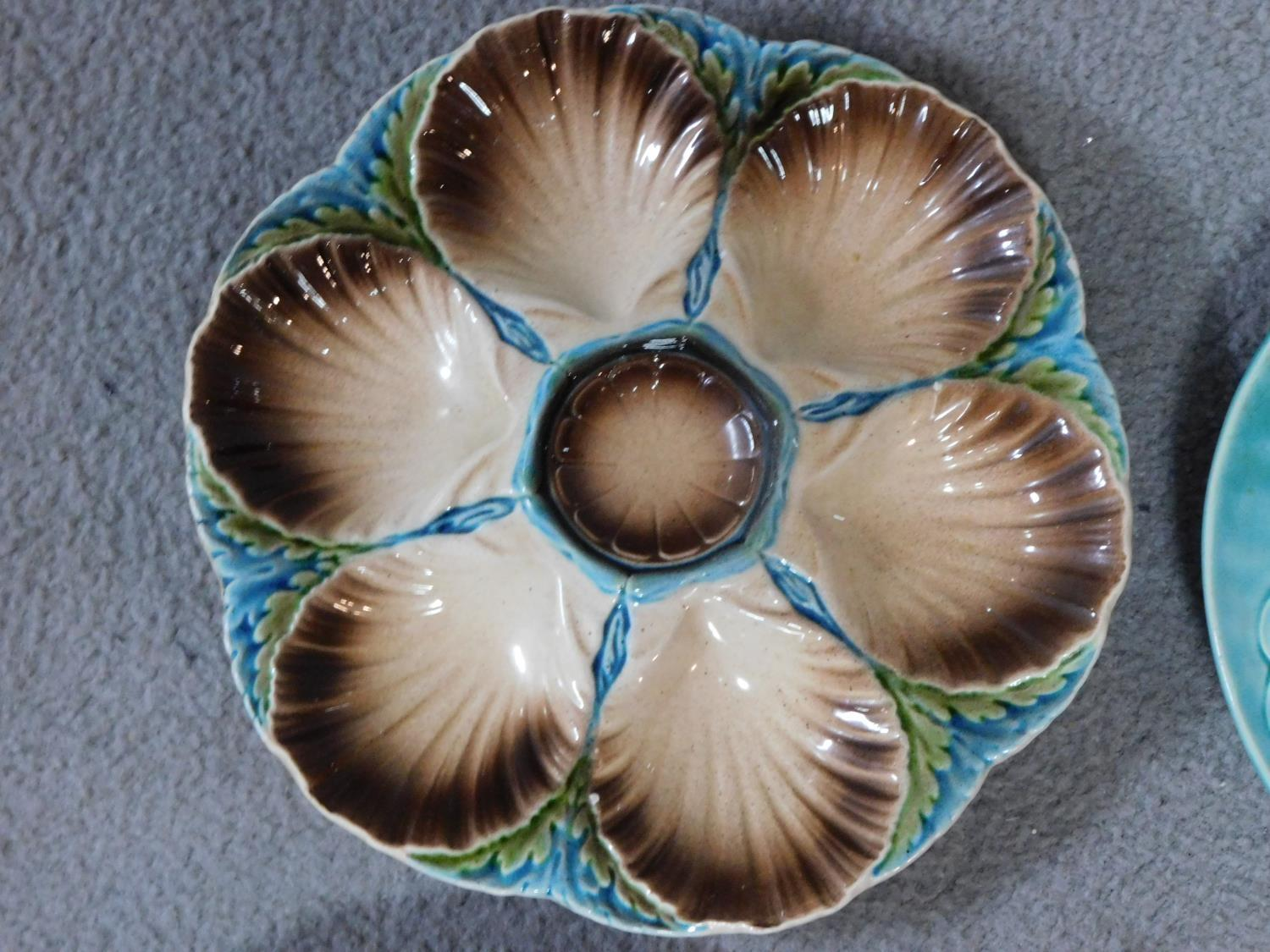 Four antique majolica plates. One designed by George Jones of pineapples in a basket, the waterlilly - Image 2 of 10