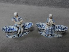 A pair of meissen blue onion pattern porcelain sweet meat dishes. One of a lady and one of a cross