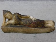 An antique painted, lacquer and gilded alabaster Burmese lying buddah sculpture. H.19 W.45cm