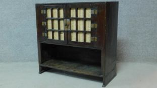 A Chinese hardwood cabinet with panel doors above open compartment. H.71 W.78 D.34cm