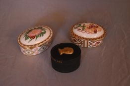 Three bone china and ceramic trinket boxes. Two by Royal Crown Derby, Wild Rose and Honeysuckle