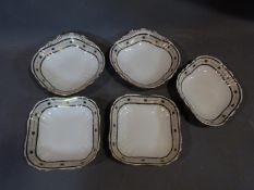 Five antique hand painted bowls by Mappin and Webb Ltd. Gilded and navy blue geometric detailing