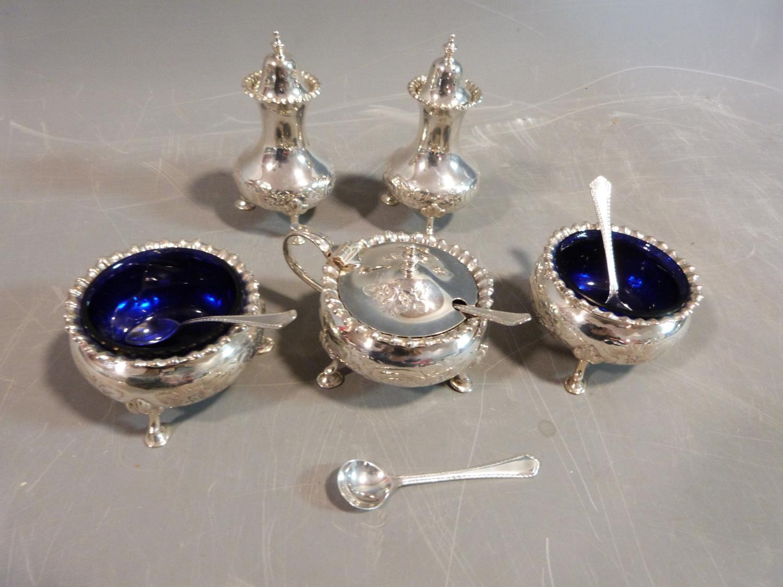 A silver floral cruet set. Hallmarked: CSG & Co. for Charles S Green & Co Ltd, Birmingham, 1954. Not