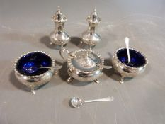 A silver floral cruet set. Hallmarked: CSG & Co. for Charles S Green & Co Ltd, Birmingham, 1954. Not