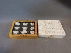 A collection of boxed Coalport and Royal Staffordshire white porcelain floral menu holders. H5cm.