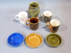 A collection of 1970's Hornsea mugs designed by John Clappison, a studio pottery vase and three