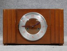 A vibtage oak and metal mantle clock. Red painted numerals. H.22 W.37 D.13cm