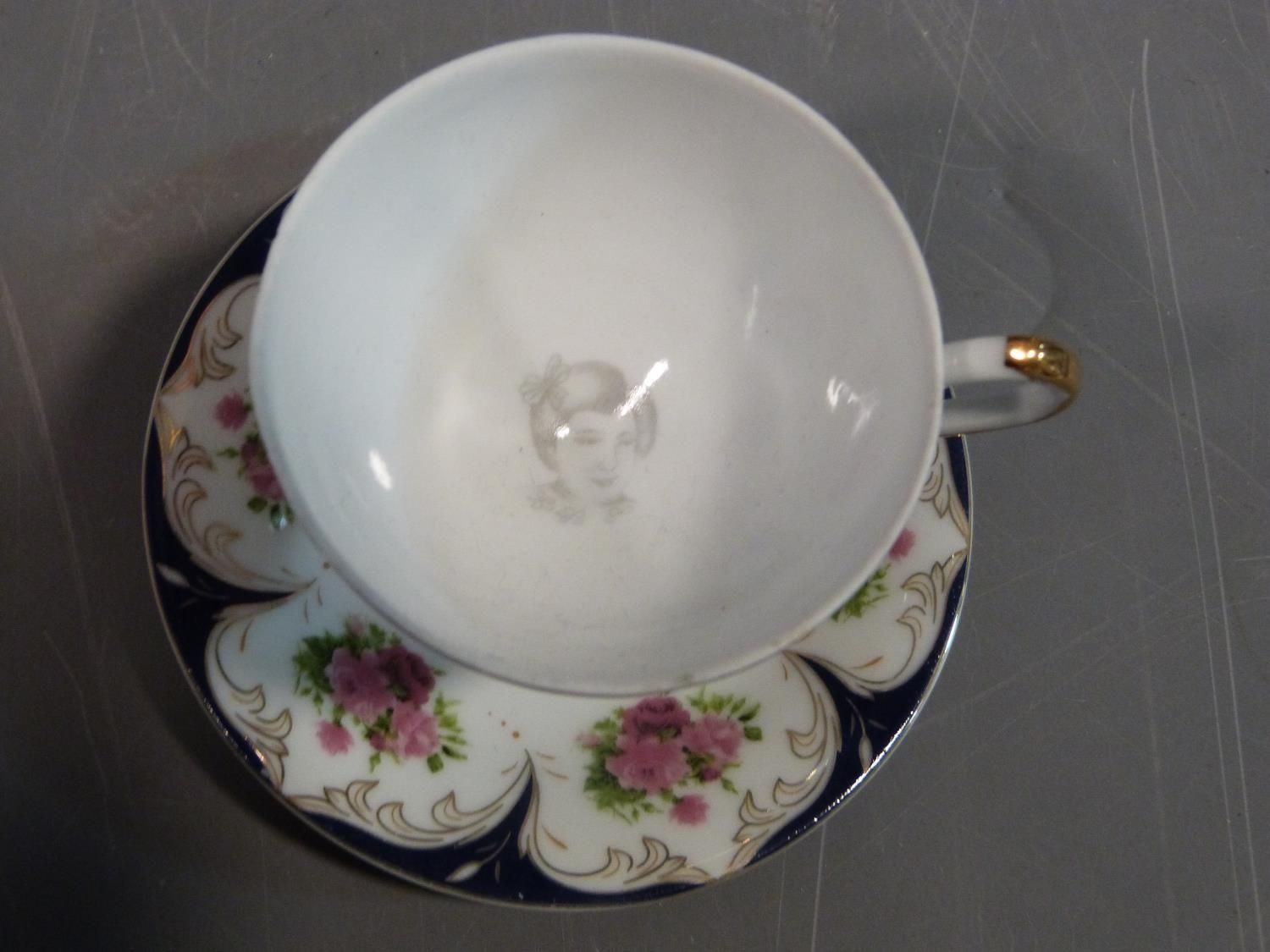 A ceramic Malaysian tea set and a pair of porcelain tea cups and saucers. The tea cups have a - Image 11 of 15