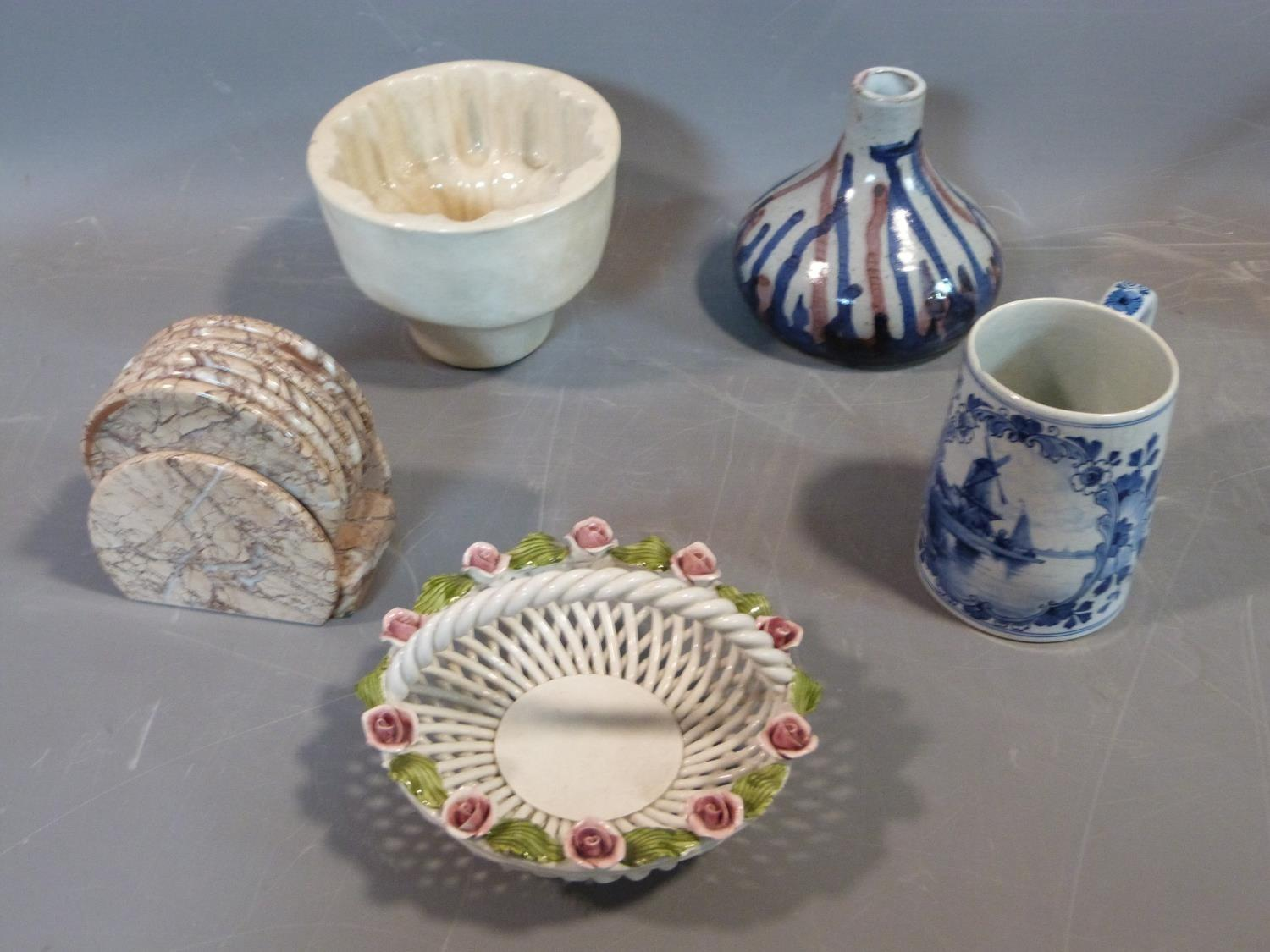 A collection of studio pottery. Including an antique ceramic jelly mould, woven Italian ceramic