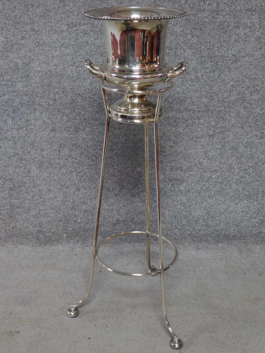A silver plated campana form wine cooler on stand. H.82cm