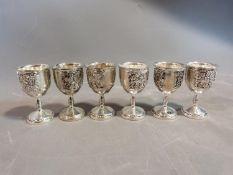 A set of six white metal silea vine design kiddush cups. H.8cm.