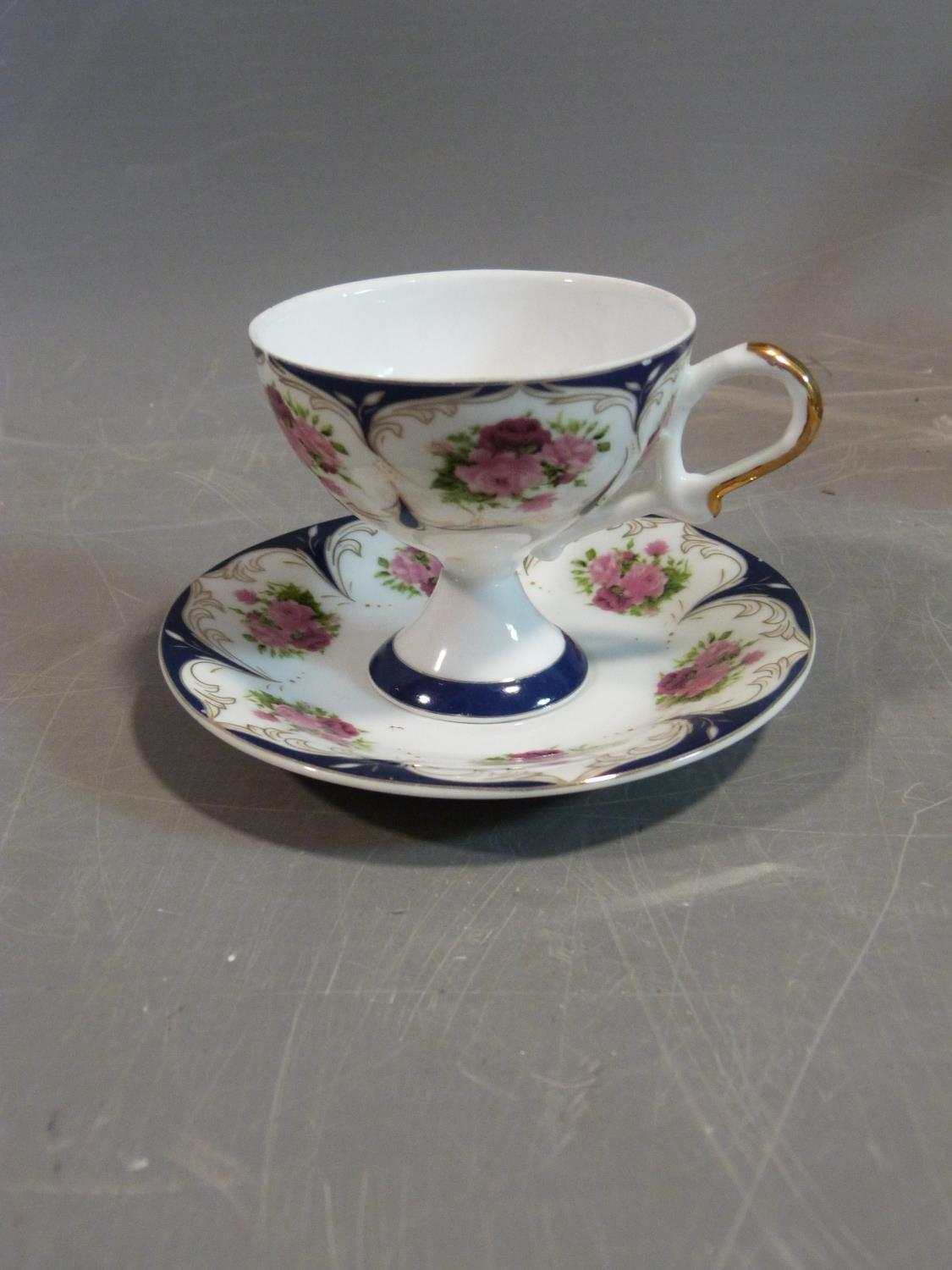 A ceramic Malaysian tea set and a pair of porcelain tea cups and saucers. The tea cups have a - Image 13 of 15