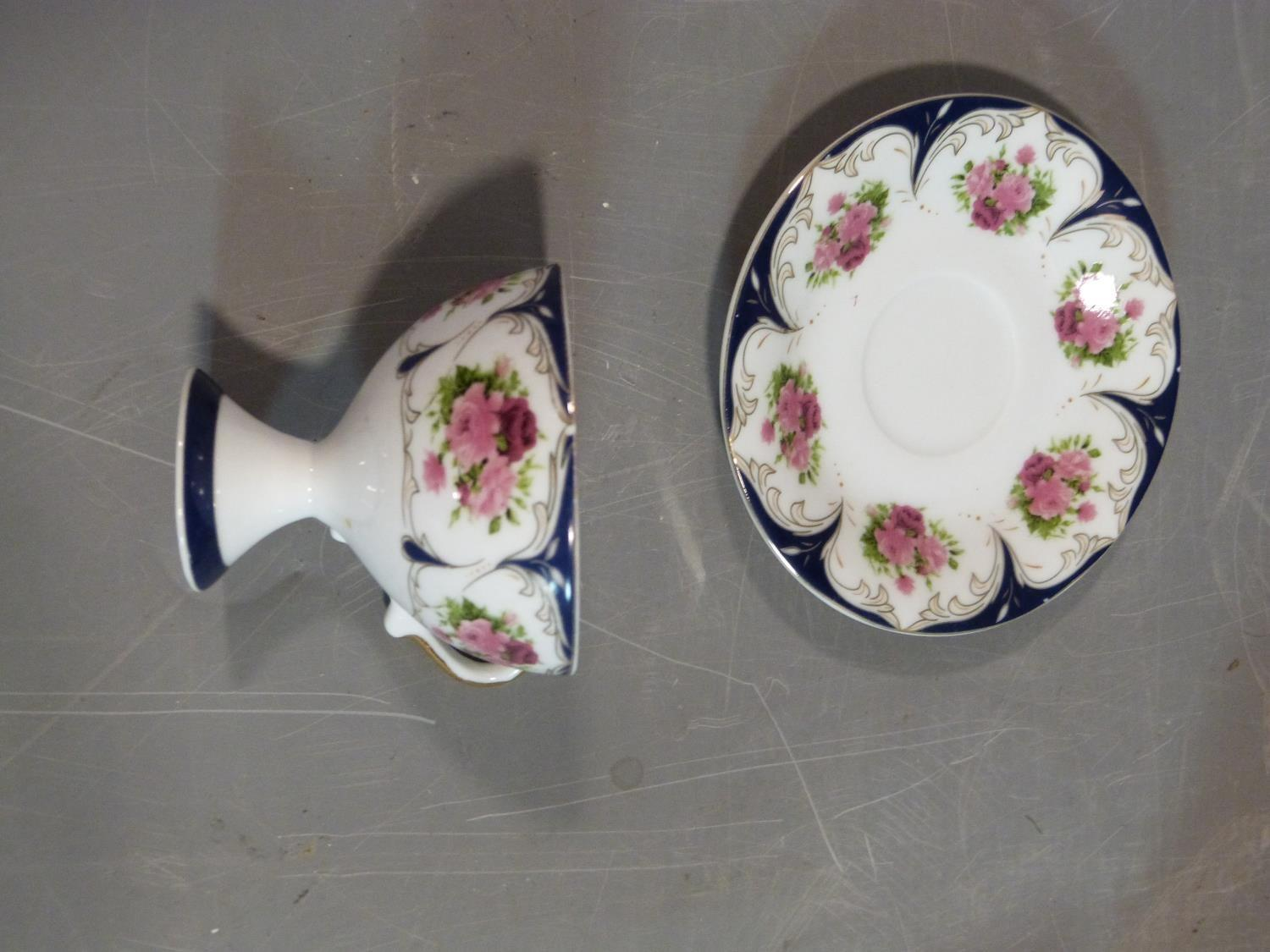 A ceramic Malaysian tea set and a pair of porcelain tea cups and saucers. The tea cups have a - Image 14 of 15