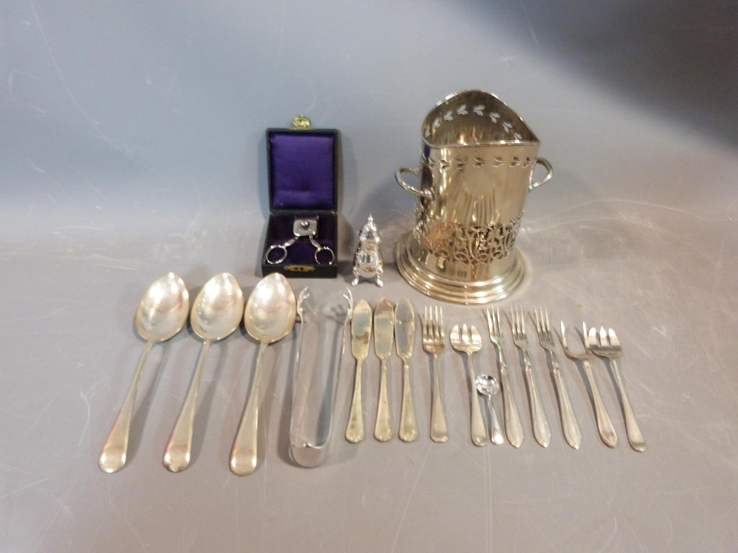 A collection of silver plate items. Including an antique razor ,a pierced two handled wine bottle
