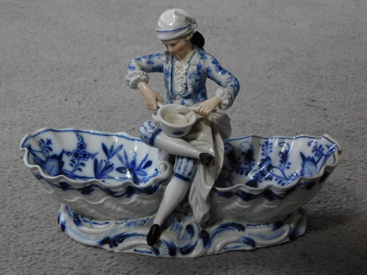 A pair of meissen blue onion pattern porcelain sweet meat dishes. One of a lady and one of a cross - Image 2 of 7