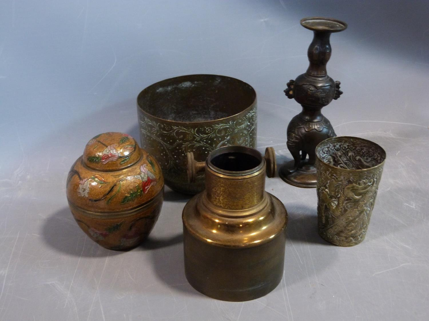 A collection of metalwork items. Including an antique adjustable magnifyer, a Chinese brass repousse