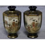 A pair of satsuma pottery Japanese vases with hand painted and gilded figures and floral design.