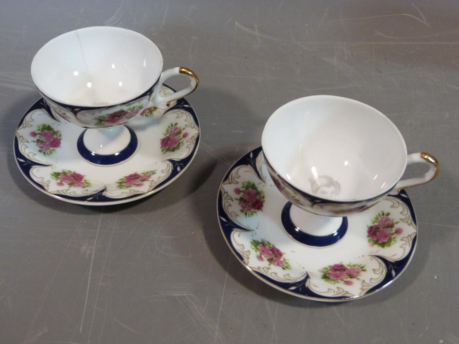 A ceramic Malaysian tea set and a pair of porcelain tea cups and saucers. The tea cups have a - Image 10 of 15
