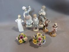 A collection of porcelain Lladro figures and ornaments. Including two porcelain flower baskets one