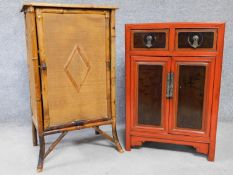 A Victorian bamboo cabinet together with a Chinese red lacquered cabinet with hand painted floral