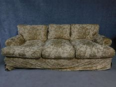 A Victorian style fully upholstered three seater sofa by George Smith on turned
