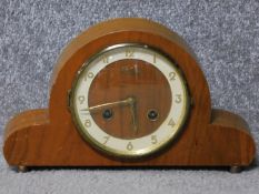 A 1930's Bentima wooden cased mantle clock. With an FHS German movement and gold tone numbers.