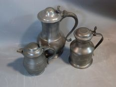 Two antique lidded petwer tankards and a jug, circa 1800. Stamped London, Crown and Rose. The