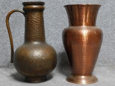 A vintage hammered copper handled jug along with a hammered copper vase with fluted edge. H.47cm