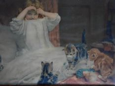 An antique framed and glazed coloured lithograph of a girl and cats. 57x41cm