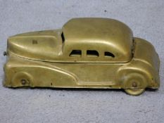 A vintage brass Betel Motor Car artist's box. Has hinged lid and removable palettes. One of the