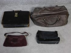 A collection of four vintage leather and suede bags. A large brown leather holdall, a plum suede