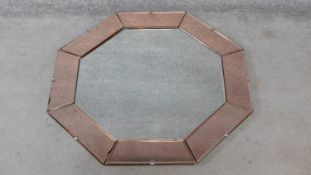 An Art Deco style mirrored peach glass octagonal bevelled wall mirror. H.80xW.80cm