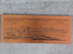 A vintage copper plate engraving of the German city of Aschaffenburg mounted on a wooden board.