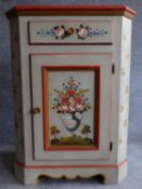A Continental style hand painted corner cabinet with frieze drawer above panel door on shaped