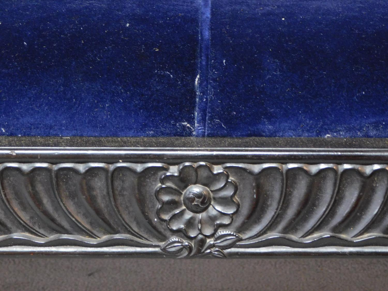 A 19th century Anglo Indian carved ebonised scroll end sofa with blue velvet upholstery on scroll - Image 6 of 9