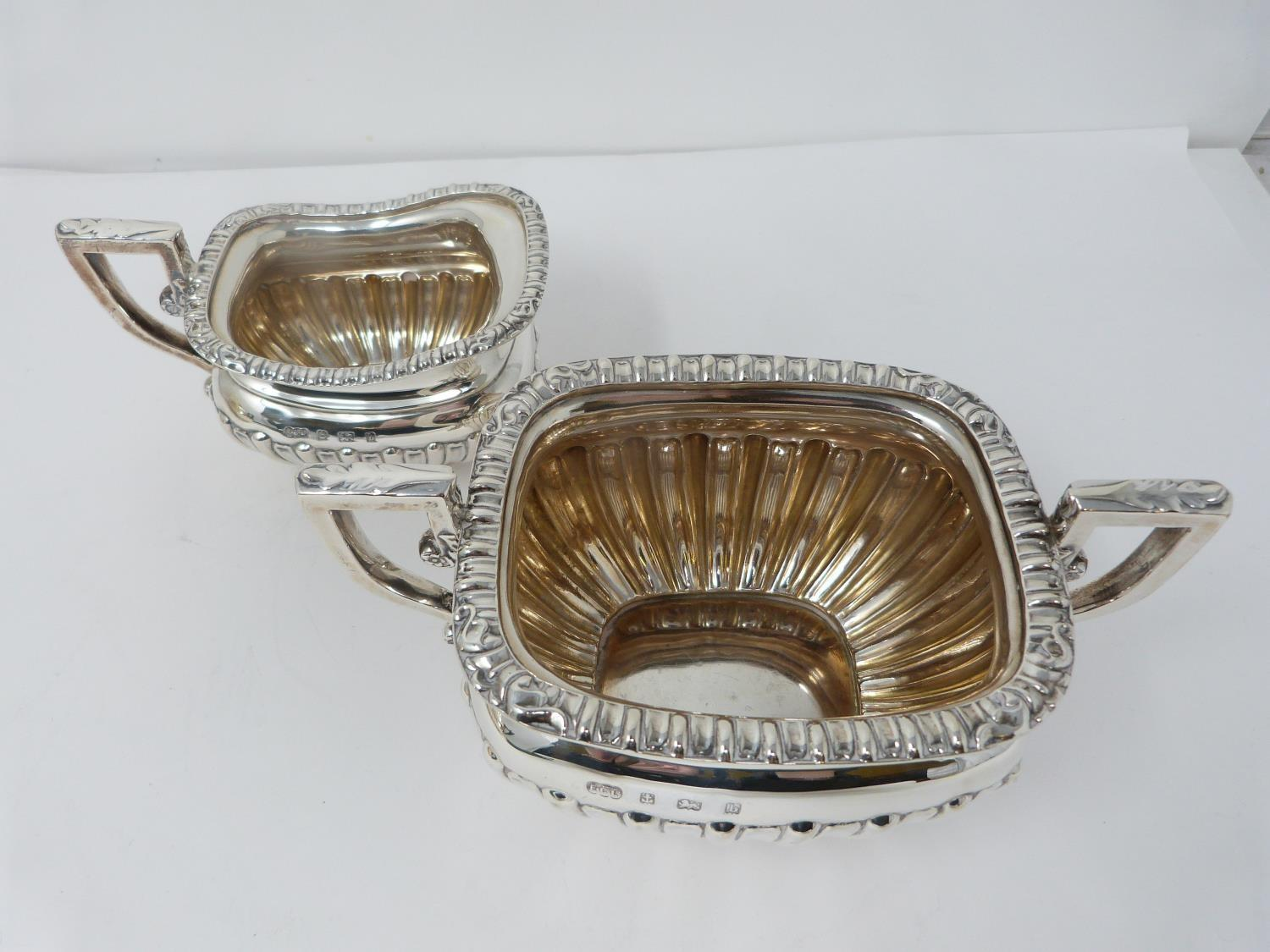 An Elkington and Co. silver three piece tea service, includes a teapot, sugar bowl and milk jug. - Image 10 of 12