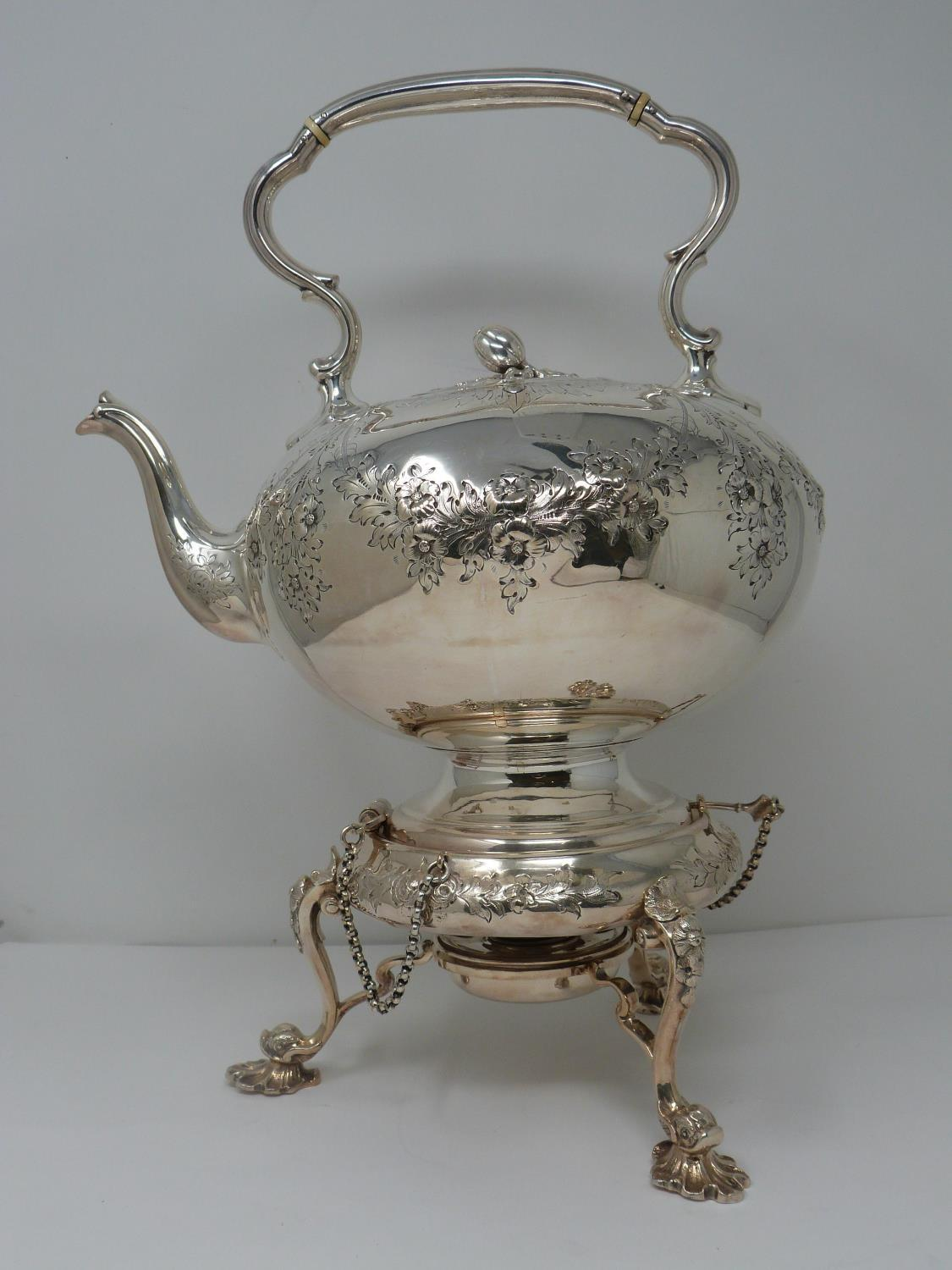 An antique white metal and ivory spirit kettle and stand. The kettle has a flower bud finial and