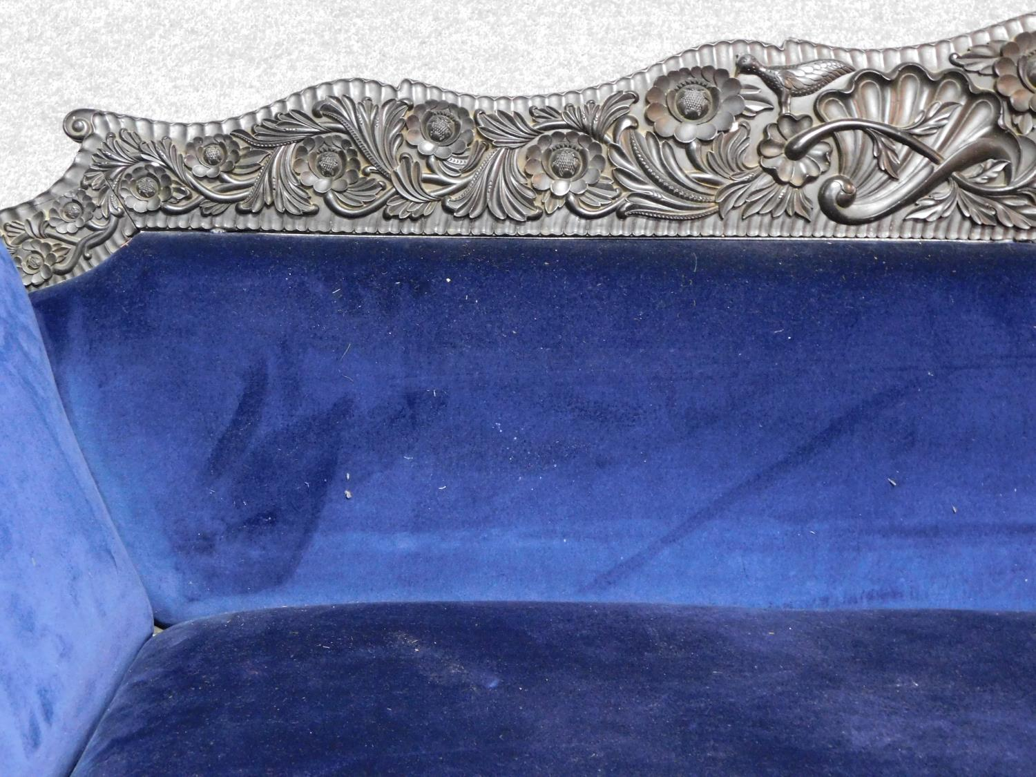 A 19th century Anglo Indian carved ebonised scroll end sofa with blue velvet upholstery on scroll - Image 3 of 9